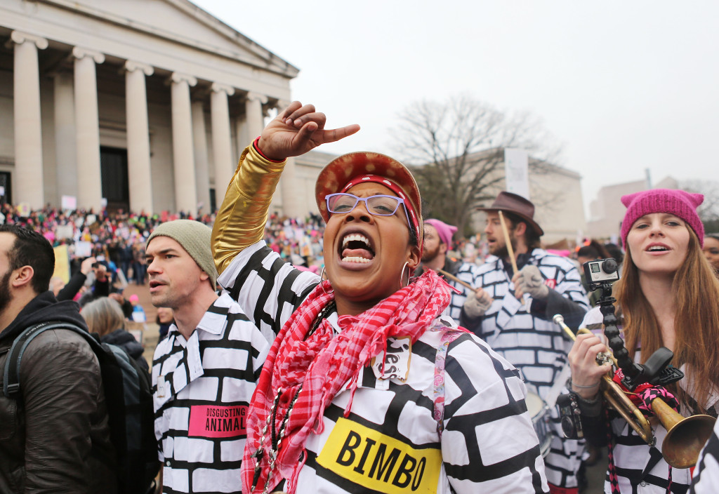 WASHINGTON, DC - JANUARY 21: A woman chants while attending the Women's March on Washington on January 21, 2017 in Washington, DC. Large crowds are attending the anti-Trump rally a day after U.S. President Donald Trump was sworn in as the 45th U.S. president. (Photo by Mario Tama/Getty Images)